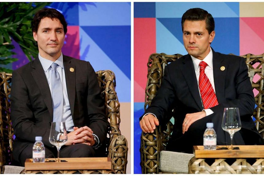 Canadian Prime Minister Justin Trudeau (left) and Mexican President Enrique Pena Nieto have had Filipino netizens gushing over their good looks.