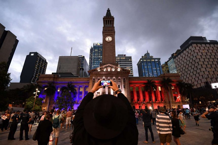 Brisbane's Town Hall lit in the colours of the French flag during a vigil for the people of France on Nov 16.