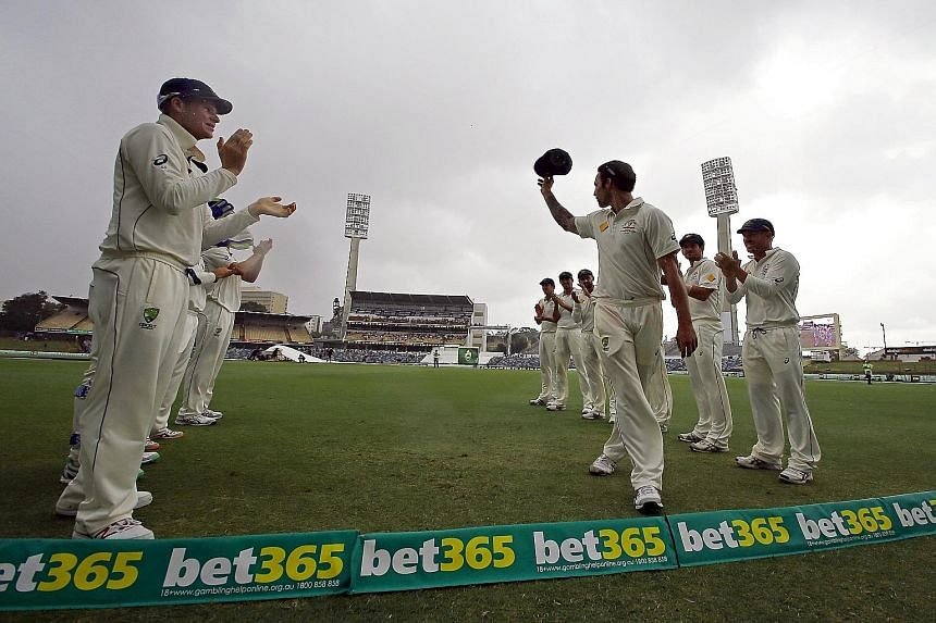Australia's Mitchell Johnson being applauded off the field by his team-mates during the final day of the second Test against New Zealand in Perth.