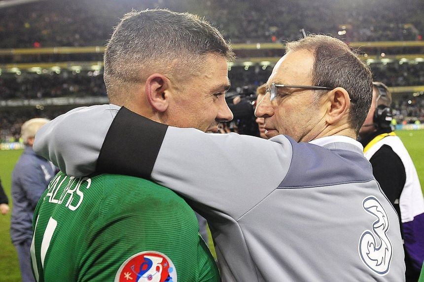 Ireland manager Martin O'Neill (left) celebrates with Jon Walters after the 2-0 win against Bosnia and Herzegovina in Dublin on Monday. Ireland sealed a Euro spot with a 3-1 aggregate victory.
