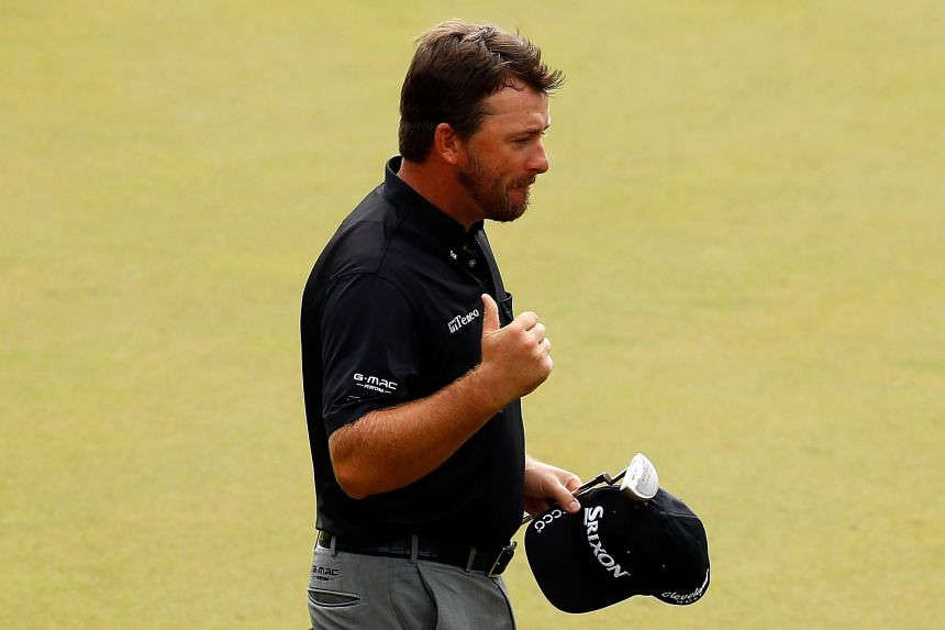 Graeme McDowell of Northern Ireland celebrates ending a two-year drought on the 18th green after winning a three-way play-off to win the OHL Classic at Mayakoba on Monday.