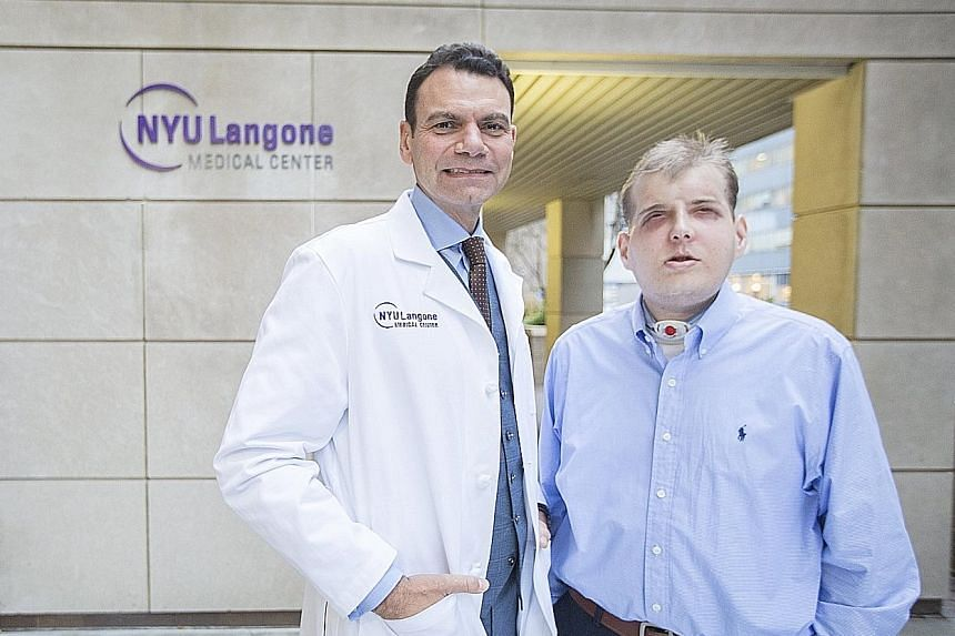 Mr Patrick Hardison with Dr Eduardo Rodriguez, who led a team of more than 100 doctors, nurses and medical staff in the 26-hour face transplant operation at NYU Langone Medical Centre in New York.