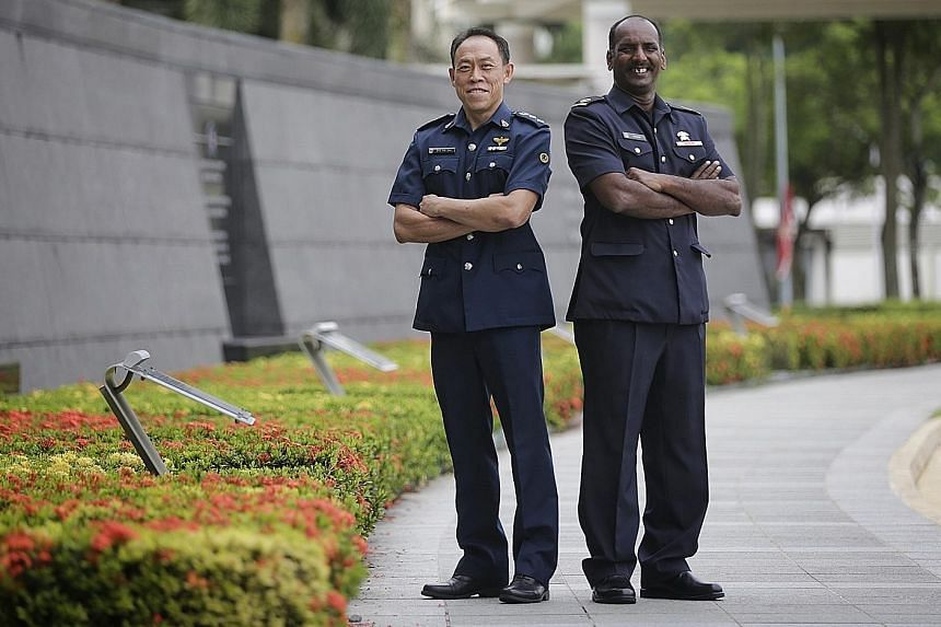 Singapore Prison Service Superintendent Ong Aik San (far left) received a Long Service Medal, while Singapore Civil Defence Force Warrant Officer Veeramani Prelathan got an Efficiency Medal at the Ministry of Home Affairs Investiture Ceremony yesterd