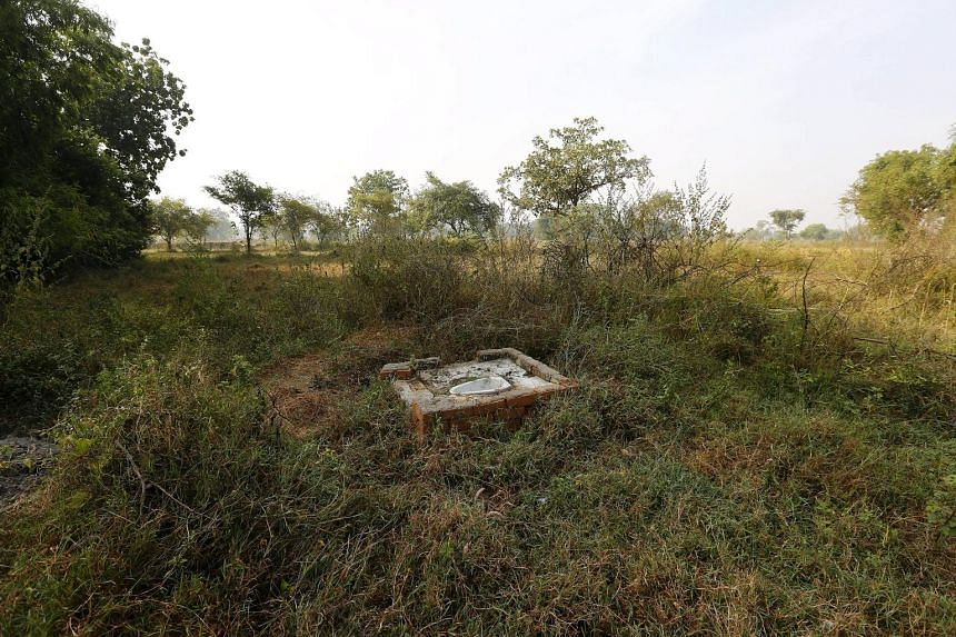 An open toilet in a field in Gorba in the eastern Indian state of Chhattisgarh, India. The government has built 9.5 million toilets in the past year, but the campaign focus is misguided, experts say. Almost half of the toilets the government built ar