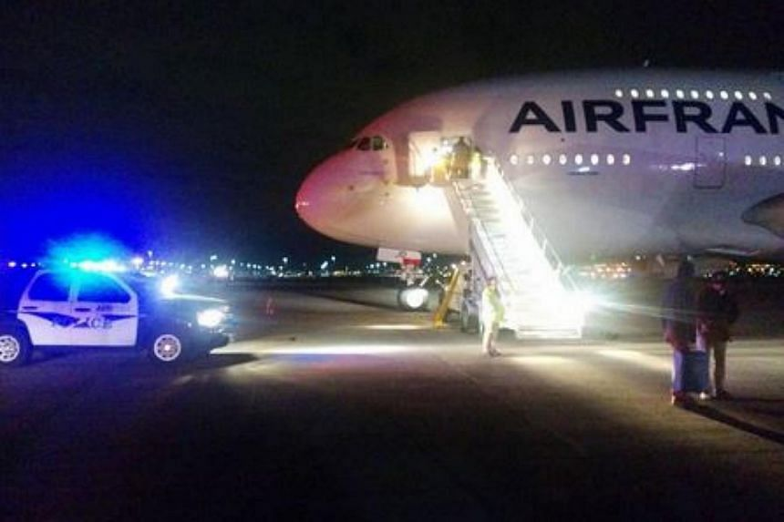Air France Flight AF65 from Los Angeles to Paris was evacuated due to security issues.