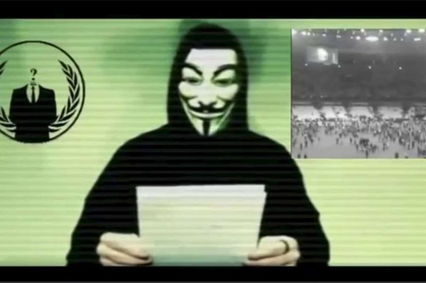 A man wearing a mask associated with Anonymous in a still image from a Nov 16, 2015, video.