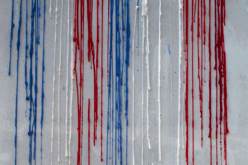 A dripped wax from candles in the colours of the French national flag pictured in front of the French Embassy in Seoul, South Korea, on Nov 17, 2015.
