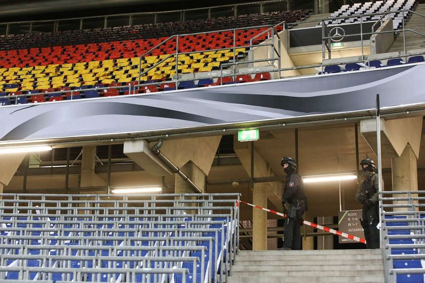 Police checks the stadium stands.