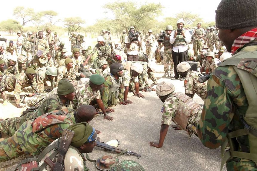 Nigerian army soldiers preparing for deployment against Boko Haram militants, on Nov 8, 2015.