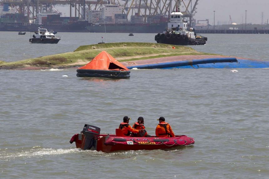 A search and rescue team patrols near the ferry KM Wihan Sejahtera after it capsized in the port of Tanjung Perak, Surabaya, on Nov 16, 2015.
