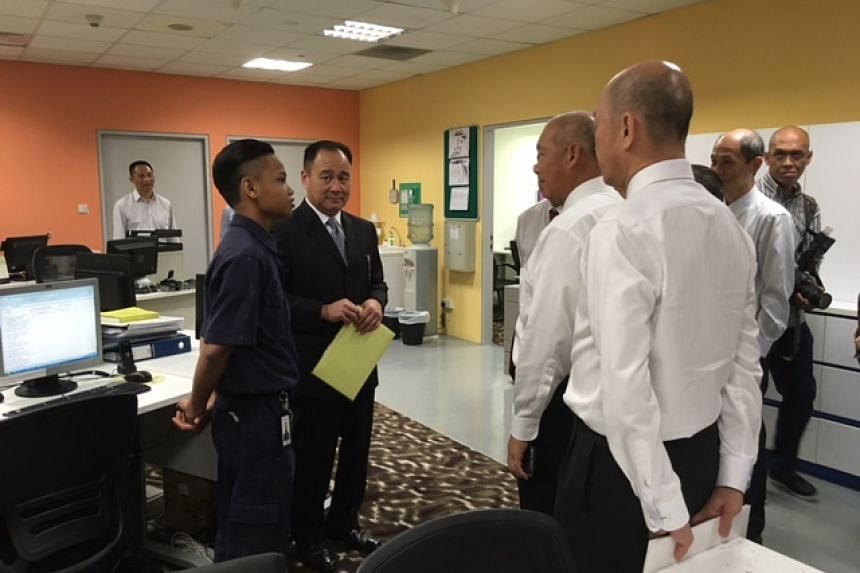 ITE board members talking to interns during a tour of their work place at Crown Plaza in Changi Airport.