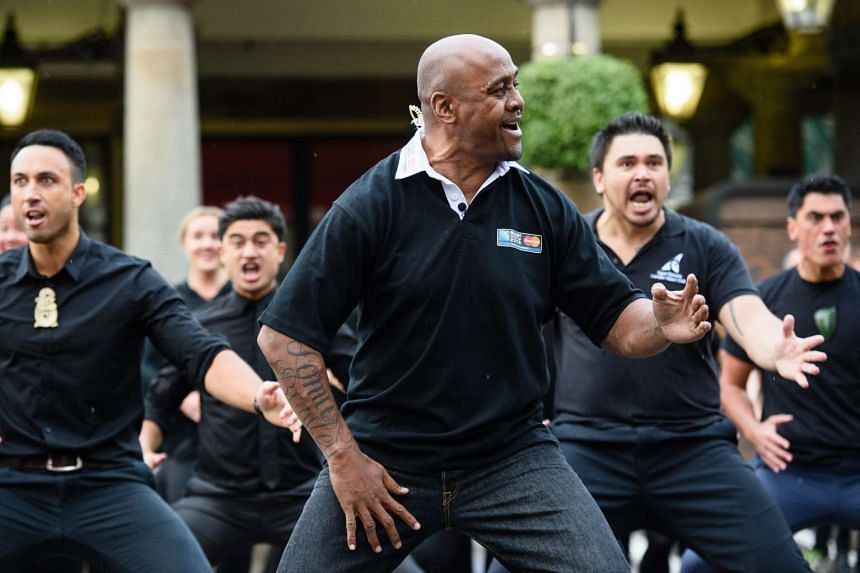 Jonah Lomu (centre) and members of the Ngati Ranana London Maori Club taking part in a haka in central London on Sept 16, 2015.