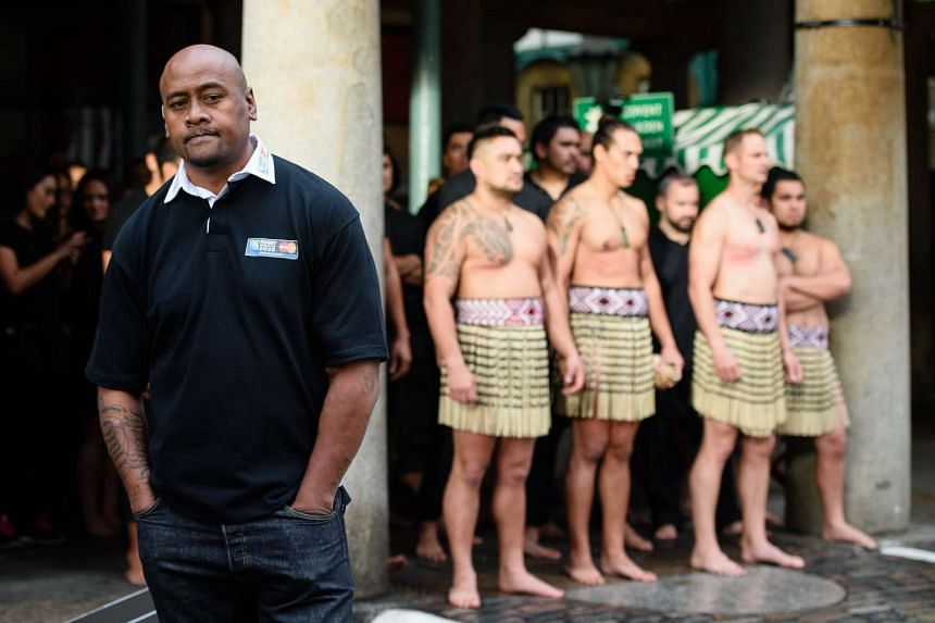 Jonah Lomu (left) and members of the Ngati Ranana London Maori Club wait to perform a haka during a photocall in London's Covent Garden.