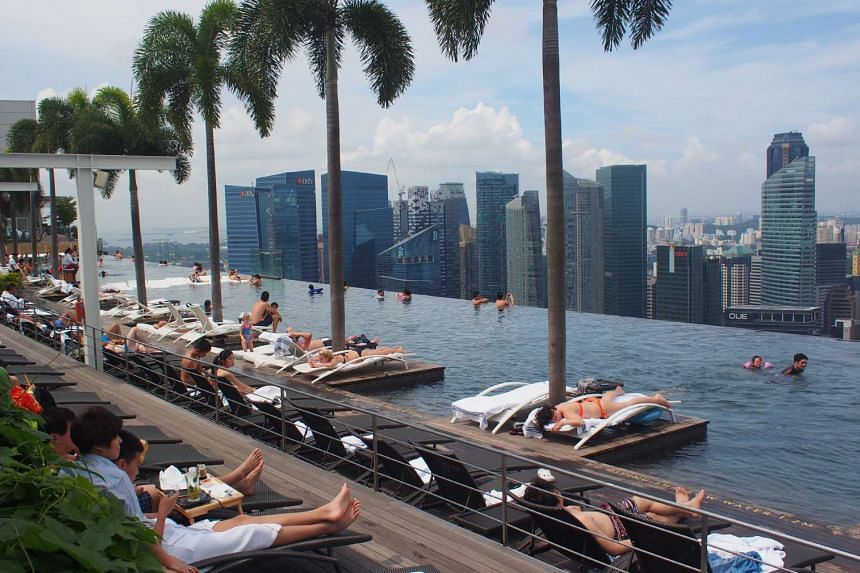 People relaxing at the Infinity Pool at Marina Bay Sands.