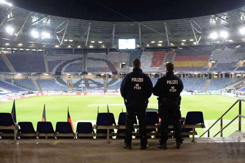 Police stands on the pitch after the friendly football match Germany versus Holland was called off.