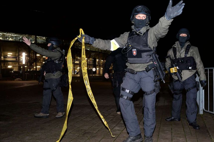 Police with assult rifles seal off the stadium.