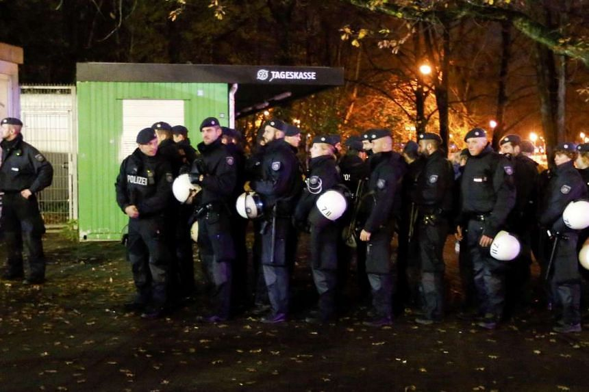 Police mass outside the stadium after the friendly between Germany and the Netherlands was called off.