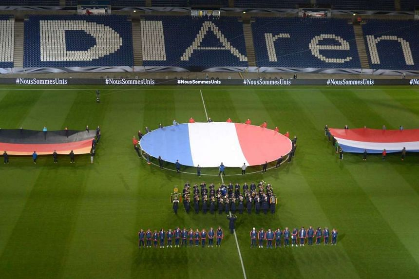 The flags of Germany, France and Holland are unfurled before the football friendly.