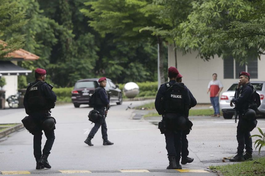 Security personnel on patrol in Dempsey Road on Monday. Singapore remains a tough target for terrorists because of its tight border control and laws on firearms, but that does not mean it is not vulnerable, say experts.