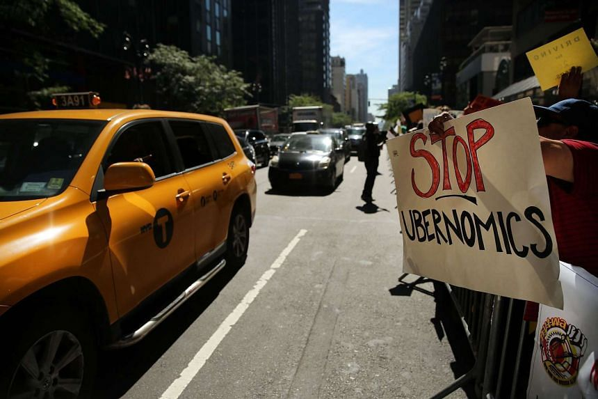 New York City taxi drivers rallying against Uber in front of Governor Andrew Cuomo's office on Sept 16.