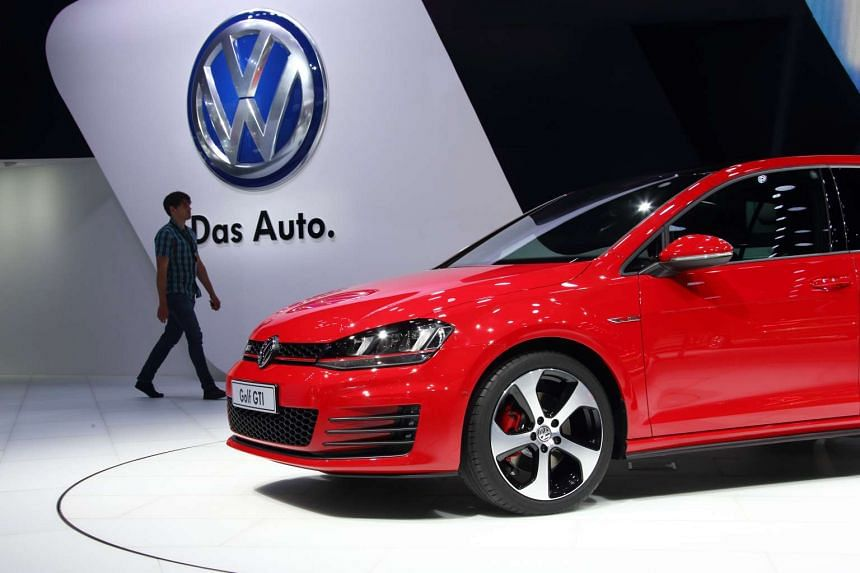 A man walking near a Volkswagen AG Golf GTI vehicle at the 16th Shanghai International Automobile Industry Exhibition in April 2015.