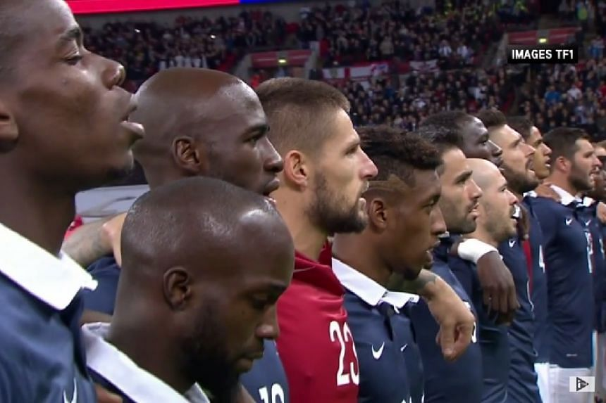 The teams sang along with the crowd to honour victims of the Paris attacks.