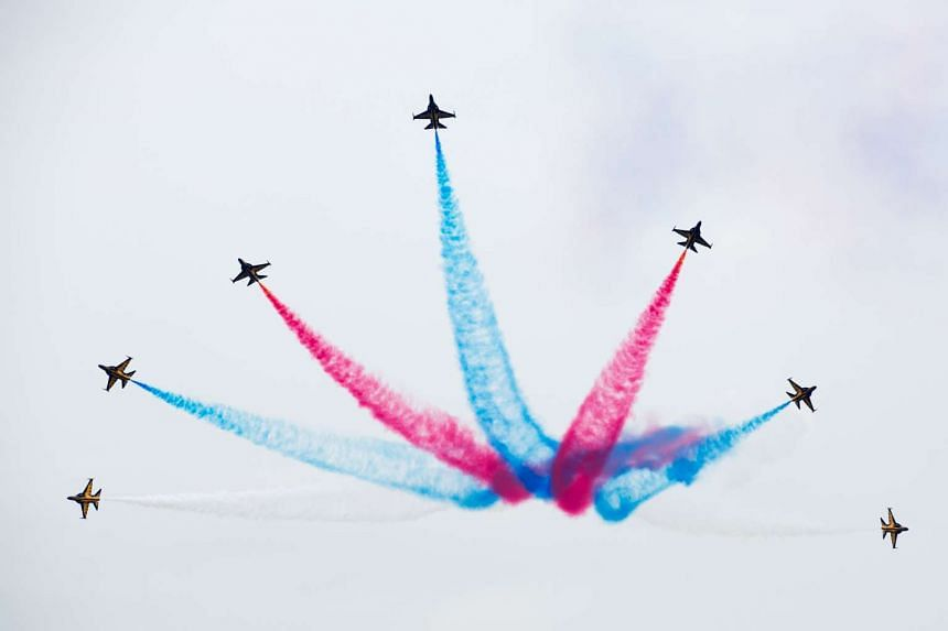 Aerobatic Flying Display at the 2014 Singapore Airshow.