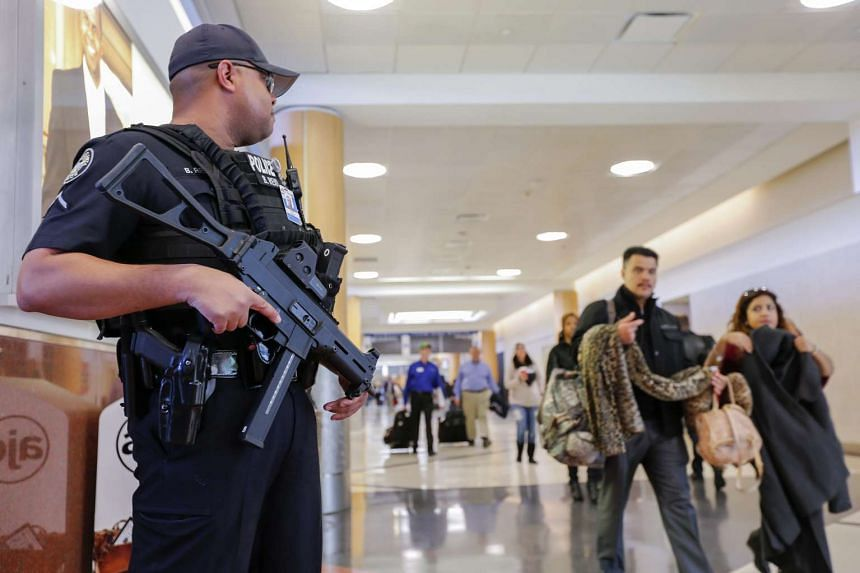 A heavily armed officer with the Atlanta Police Department stands guard in the main domestic terminal at Hartsfield-Jackson Atlanta International Airport.