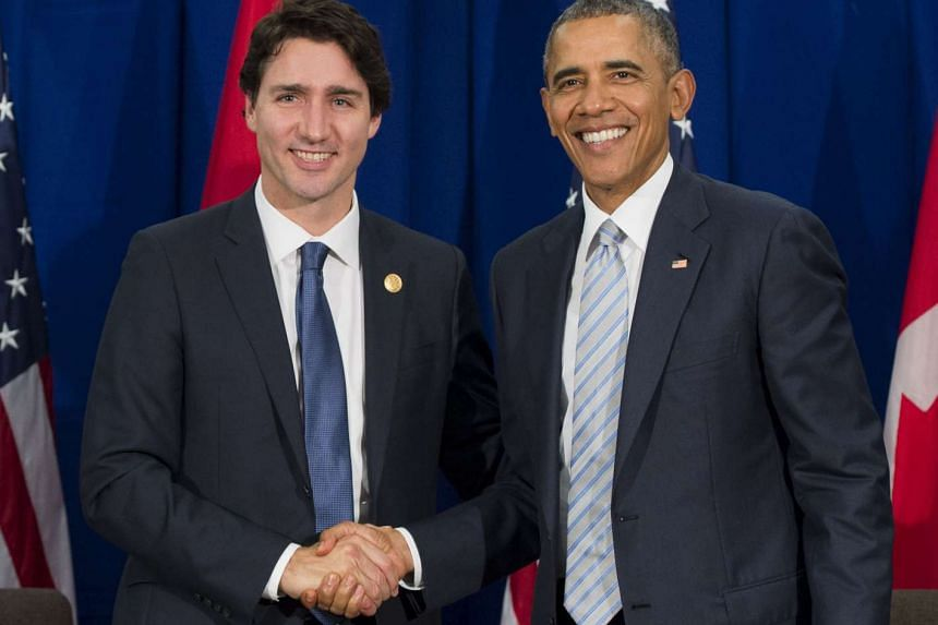 Barack Obama and Justin Trudeau (Left) shake hands during their meeting at the Apec summit.