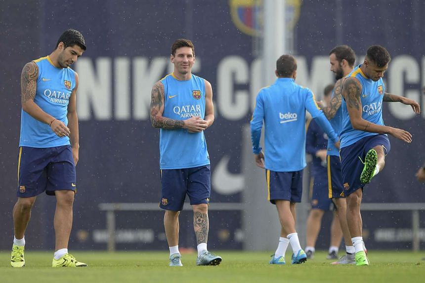 (From left) Barcelona's Luis Suarez, Lionel Messi and Neymar da Silva Santos Junior taking part in a training session on Aug 22, 2015.