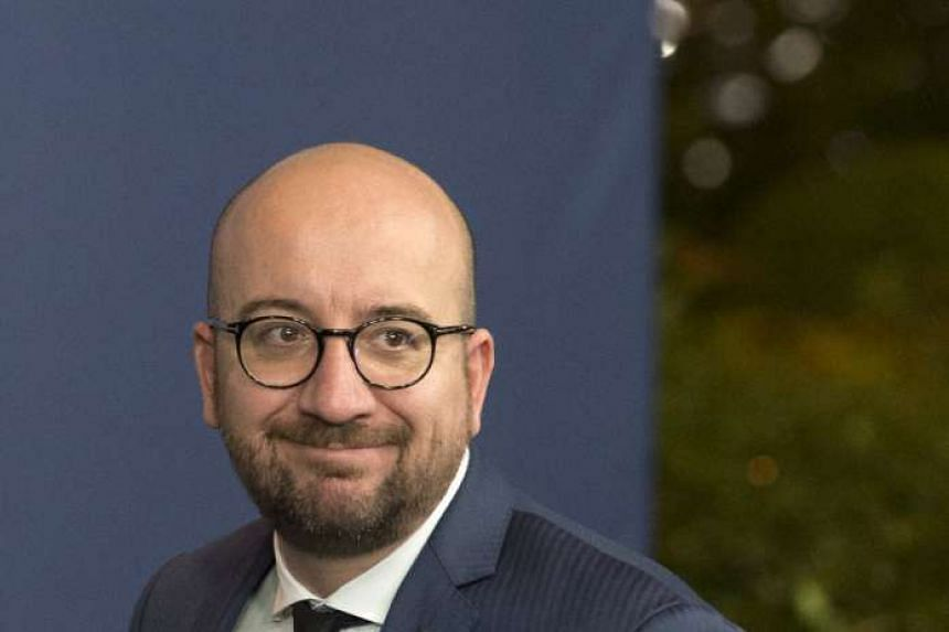 Belgium's Prime Minister Charles Michel leaves the European Council headquarters at the end of a European Union leaders summit in Brussels on Oct 16, 2015.