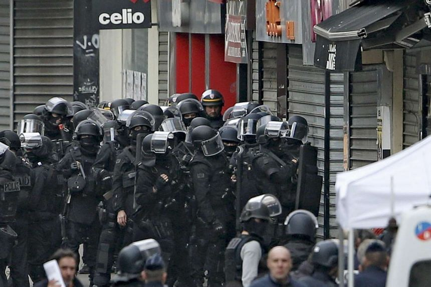 Members of special French RAID forces seen at a raid zone in Saint-Denis, near Paris, France, Nov 18, 2015, during an operation to catch fugitives from recent deadly attacks in the French capital.