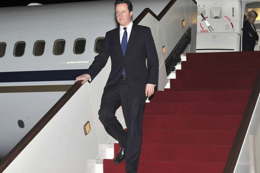 British Prime Minister David Cameron arriving in Muscat on Feb 13, 2011.
