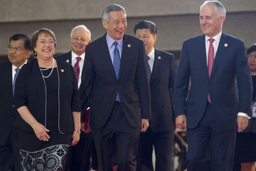 (From left) Chile President Michelle Bachelet, Singapore Prime Minister Lee Hsien Loong and Australian Prime Minister Malcolm Turnbull arriving for a photo shoot at the APEC summit in Manila on Nov 19. Behind them are (from left) Indonesian Vice-Pres