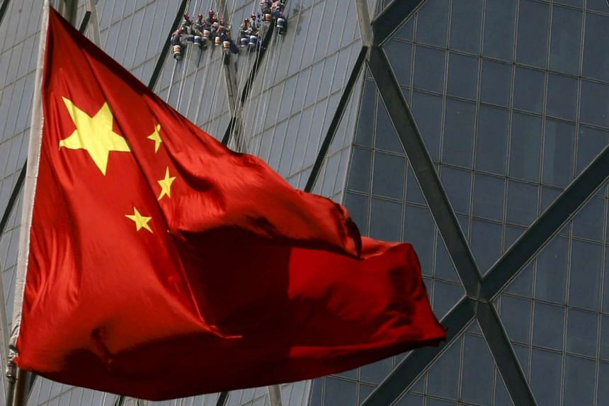 China's national flag at a commercial district in Beijing, China.