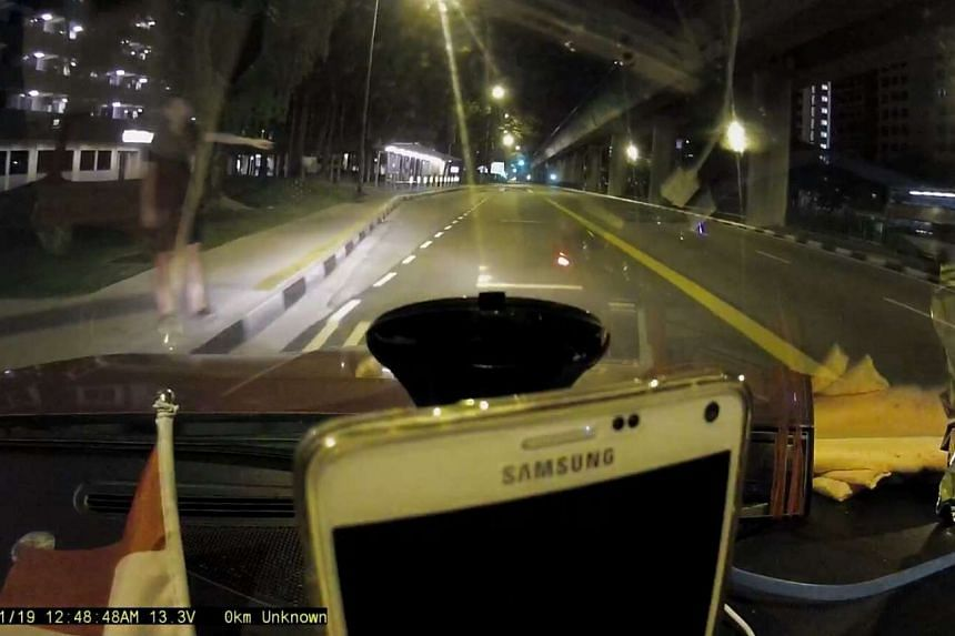 The suspect seen in the taxi's dashboard camera, when Mr Zheng stopped to pick him up.