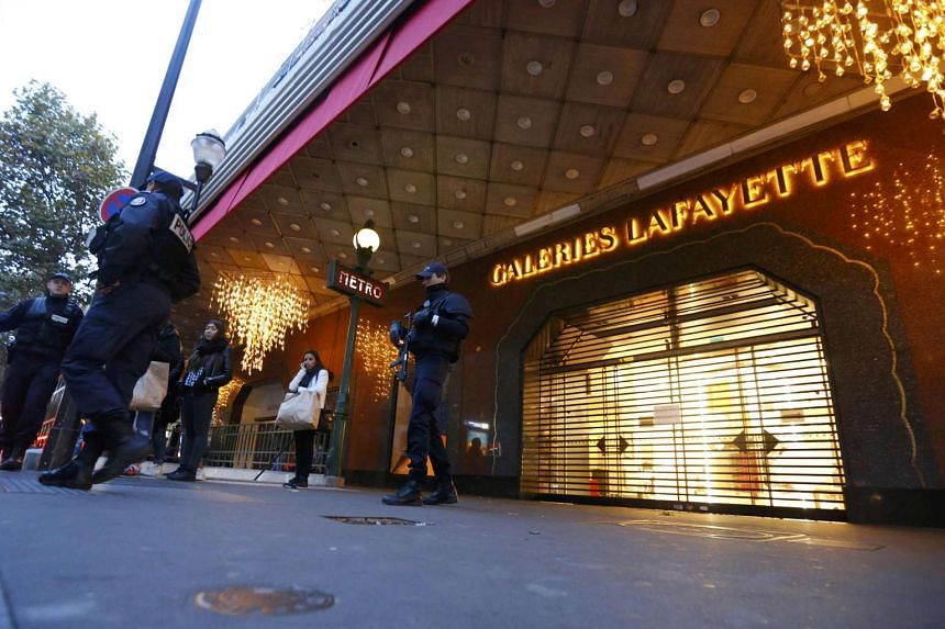 French police officer patrolling near the Galeries Lafayette department store in the shopping district in Paris on Nov 14, 2015.