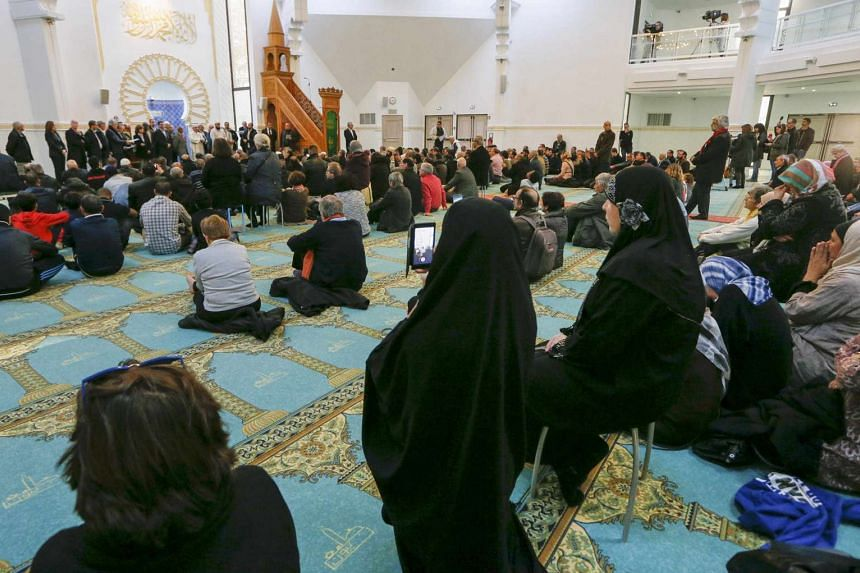 Several hundred people, Muslims and non-Muslims, gather to pray at the Grande Mosque in Lyon, France on Nov 15, 2015, for the victims of the series of shootings in Paris.