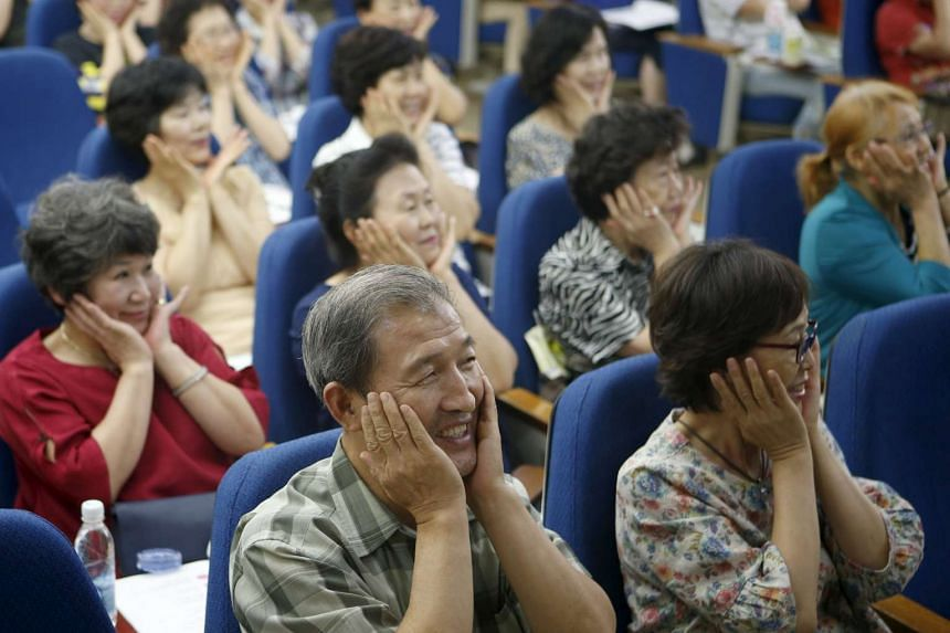 South Korean grandparents taking part in a childcare class in Seoul on Sept 1.
