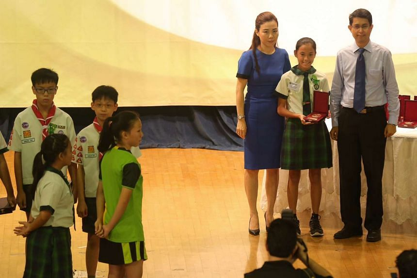A Tanjong Katong Primary School student presented with the TKP Braveheart Award.