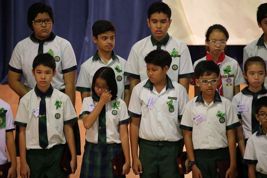Some of the Tanjong Katong Primary School students on stage after receiving the TKP Braveheart Award.