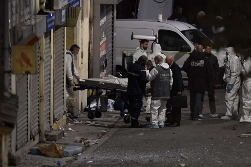 A second body is removed from the apartment in the northern Paris suburb of Saint-Denis, on Nov 18, 2015, hunting those behind the attacks that claimed 129 lives in the French capital.