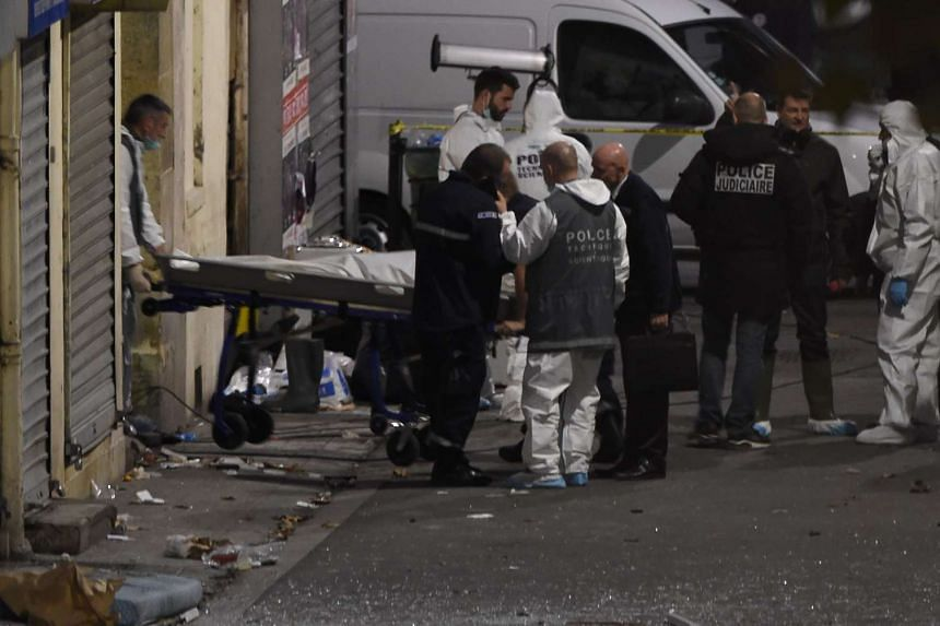 A second body is removed from the apartment raided by French police special forces.