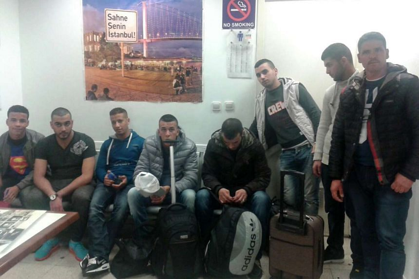 A handout picture provided by the Istanbul Police Department showing eight Moroccan men who allegedly support ISIS.