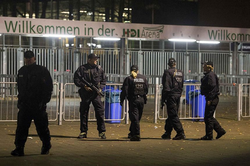 Armed police patrolling in front of the Hanover football stadium, after the Germany Netherlands international friendly match was called off due to a security threat.