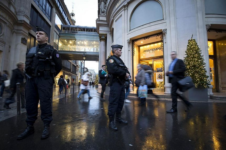 French gendarmes patrolling outside the Printemps department stores on Nov 19, 2015 in Paris.