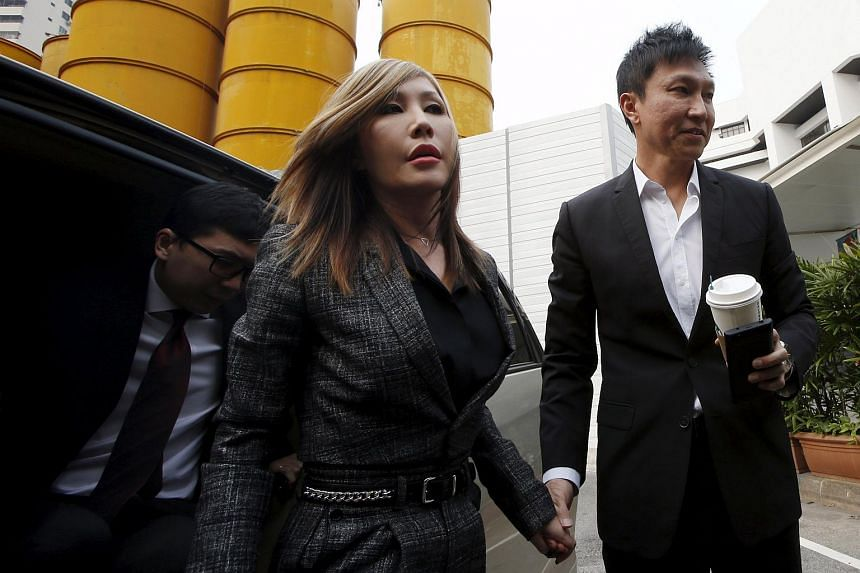 City Harvest Church founder Kong Hee (right) and his wife Sun Ho arriving at the State Courts in Singapore on Oct 21, 2015.