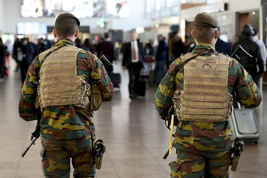 Military police soldiers patrol the Brussels Airport on Nov 18, 2015 in Zaventem, eastern Brussels.