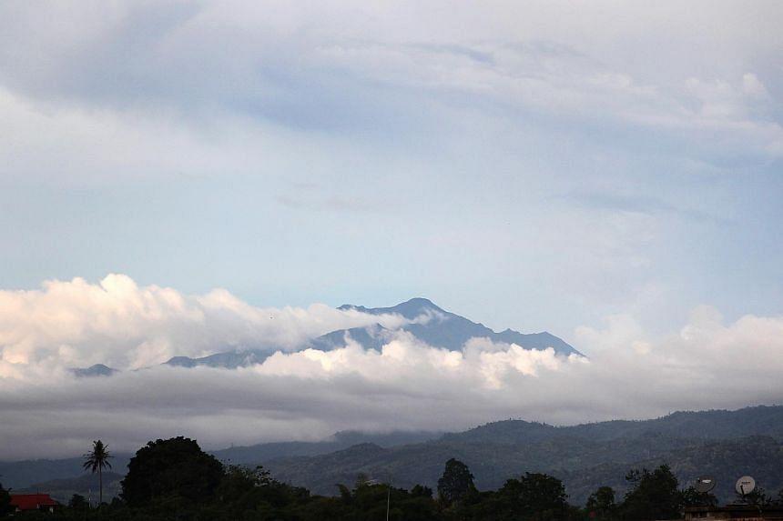 The peak of Mount Kinabalu as seen from Keningau, Sabah, on April 24, 2013.