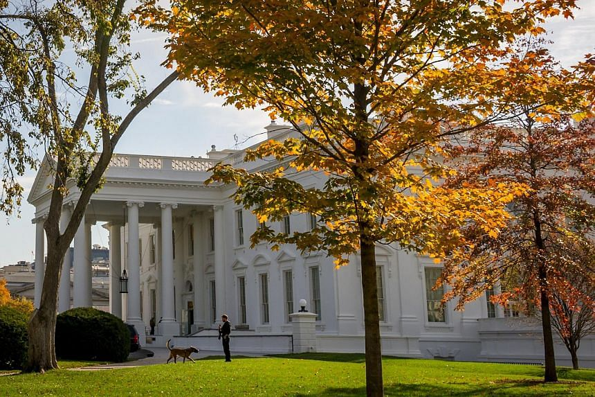 A US Secret Service agent patrolling the North Lawn of the White House on Oct 31.